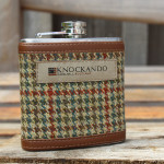Tweed covered hip flask with leather trim